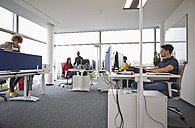 Colleagues working in open-plan office - RHF000946