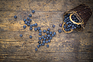 Blueberries and wickerbasket on wood - LVF003686