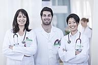 Portrait of three smiling doctors - ZEF006076