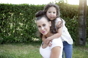 Little girl hugging her mother - GDF000830