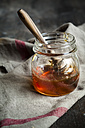 Honey in glass with wooden honey spoon - SBDF002185