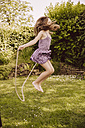 Girl  jumping rope in garden - MFF001873