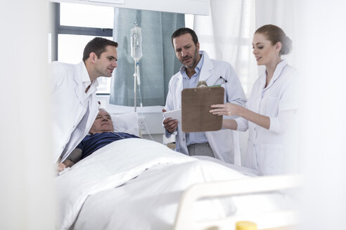 Two doctors, nurse and patient in a hospital room - ZEF006230