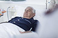 Senior man sleeping in a hospital bed - ZEF006231