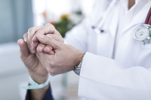 Doctor holding patient's hand, close-up - ZEF006248