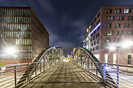 Germany, Hamburg, pedestrian Bridge between Speicherstadt and Hafencity at night - NKF000314