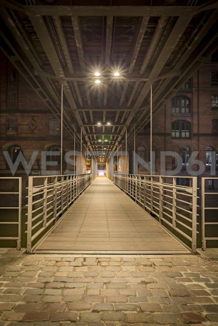 Germany, Hamburg, pedestrian Bridge between Speicherstadt and Hafencity at night - NKF000317