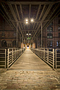 Germany, Hamburg, pedestrian Bridge between Speicherstadt and Hafencity at night - NKF000317