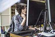 Young woman in office working at computer - FKF001208