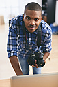 Portrait of young man in his photographic studio - EBSF000779
