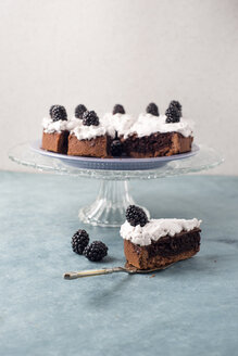 Sliced chocolate cake with creme and blackberries - MYF001097