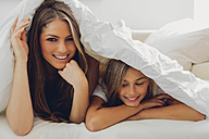 Happy mother and daughter under blanket - CHAF000877