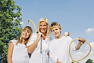 Portrait of happy woman and her  children with tennis rackets - CHAF000913