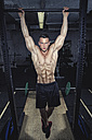 Physical athlete doing chin-ups - MADF000417