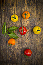 Six different tomatoes on wood - LVF003708
