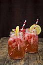 Two glasses of homemade watermelon lemonade on wood - LVF003732