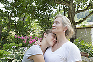 Mother and daughter hugging - SGF001790