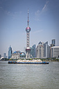 China, Shanghai, Oriental Pearl Tower and cargo ship on the Huangpu River - NKF000320