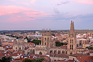 Spain, Castile and Leon, Burgos, Cityscape with Cathedral in the evening - LAF001436