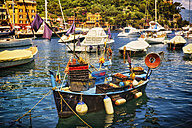 Italy, Liguria, Portofino, fishing boat in harbor - DIKF000144