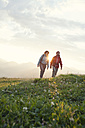 Austria, Tyrol, couple hiking at Unterberghorn at sunrise - RBF002965