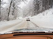 Austria, Kitzbuehel Region, cars on road in winter landscape - AMF004118