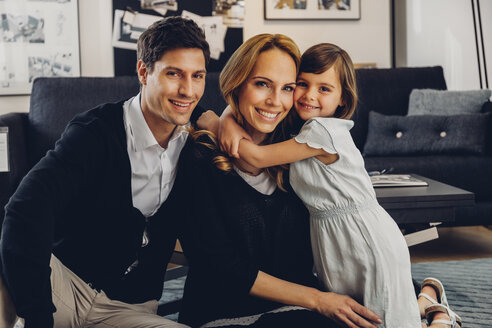 Happy family with daughter in living room - CHAF000995