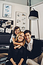 Happy family with daughter in living room - CHAF000997