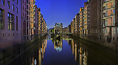 Germany, Hamburg, view to lighted Old Warehouse District by night - TIF000073