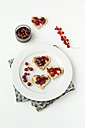 Toast bread hearts with currant jelly on plate - MYF001087
