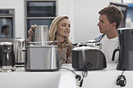 Young couple shopping kitchen equipment - ZEF007230