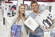 Young couple shopping kitchen equipment - ZEF007351
