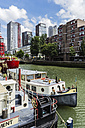 Netherlands, Rotterdam, Wijnhaven with moored boats - THAF001411