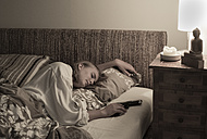 Woman sleeping with pistol in her hand - FC000712