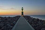 Germany, Warnemuende, view to lighthouse at dusk in front of the Baltic Sea - RJF000466