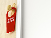 Tag with 'Do not disturb' hanging on doorknob - AHUF000021