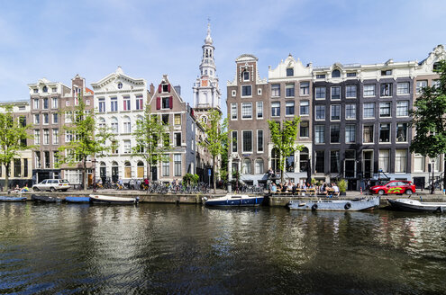 Netherlands, Amsterdam, Houses at town canal, Zuiderkerk in background - THAF001423