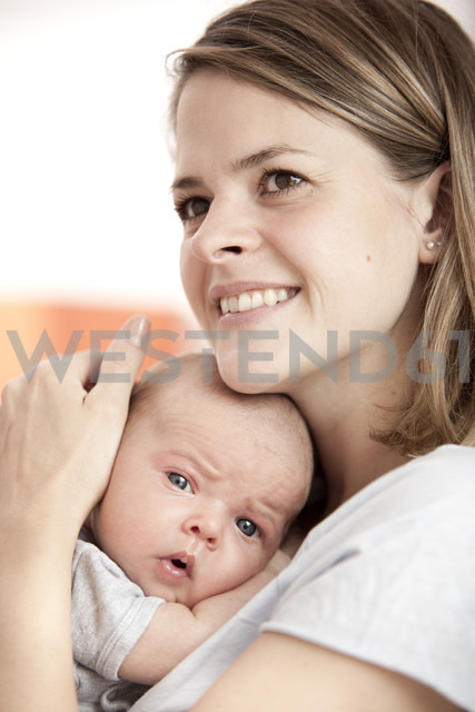 Portrait of happy young woman with her baby - MFRF000299