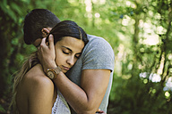 Young woman resting her head on the chest of her boyfriend - RAEF000267