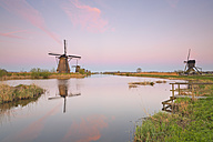 Netherlands, Kinderdijk, Kinderdijk wind mills at twilight - MEMF000898