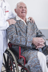 Doctor and smiling elderly patient in wheelchair - ZEF007251