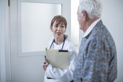 Doctor with elderly patient in hospital - ZEF007258