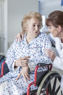 Doctor caring for elderly patient in wheelchair - ZEF007290
