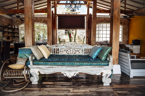 Indonesia, Bali, wooden classic Indonesian daybed in a holiday villa - MBEF001399