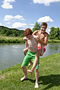 Teenage boy giving his friend a piggy back ride - LBF001152