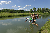 Germany, Bavaria, kids and man jumping into River Loisach - LBF001169