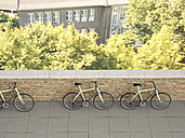 Three racing cycles standing against a wall, 3D Rendering - UWF000571