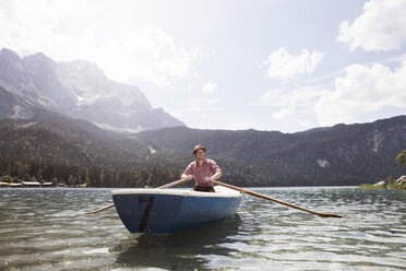 Germany, Bavaria, Eibsee, man in rowing boat on the lake - RBF003011