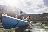 Germany, Bavaria, Eibsee, couple in rowing boat on the lake - RBF003034