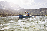 Germany, Bavaria, Eibsee, couple in rowing boat on the lake - RBF003037